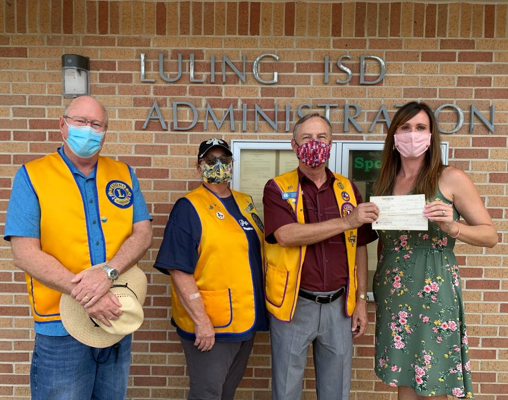 Lion's Club Members present Superintendent Warren with a Generous Donation